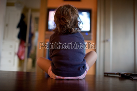 young girl watching television close up