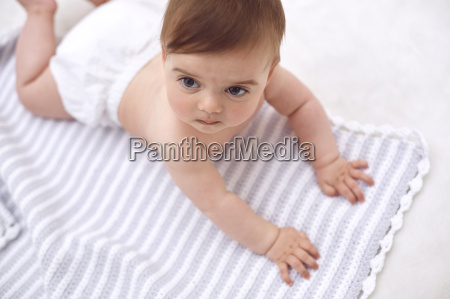 portrait of baby girl lying on