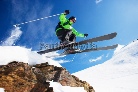 male skier jumping at speed down