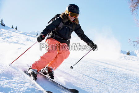 female skiing downhill