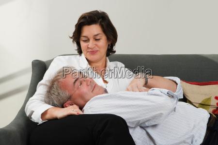 man resting head on wifes lap