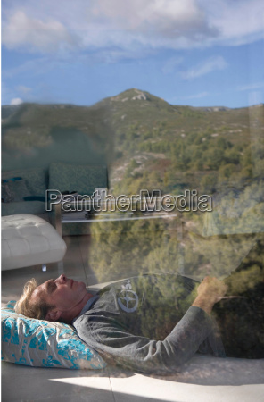 man sleeps on floor in living