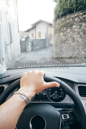 hand on steering wheel and view