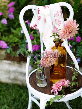 flowers in vintage glass bottles on