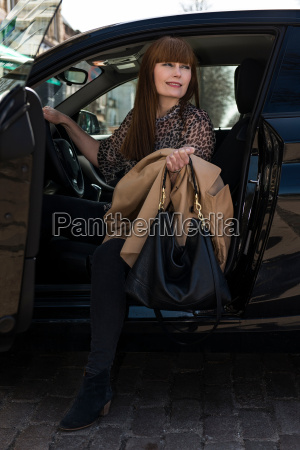 business woman getting out of car