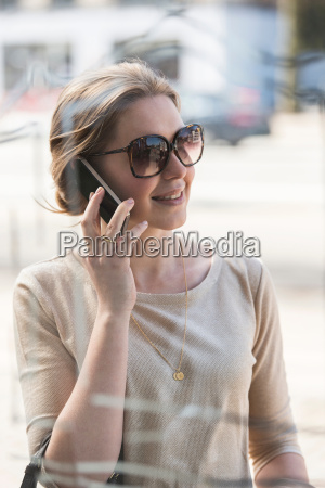 young woman on mobile phone outside