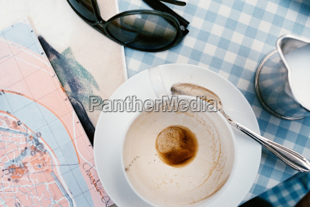 empty cup and map on cafe
