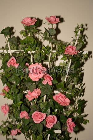 artificial flowers on trellis