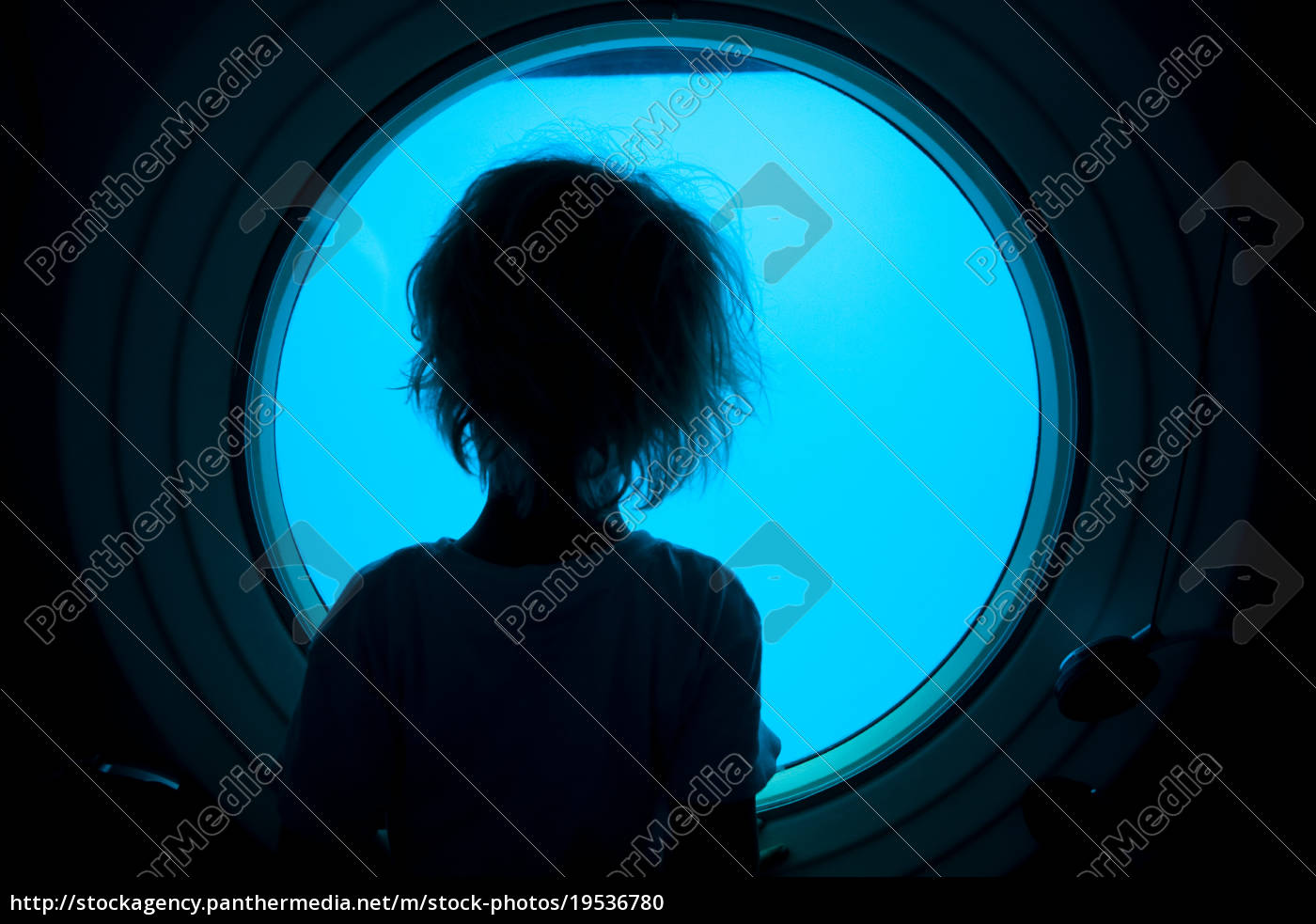 young, boy, looking, through, porthole - 19536780