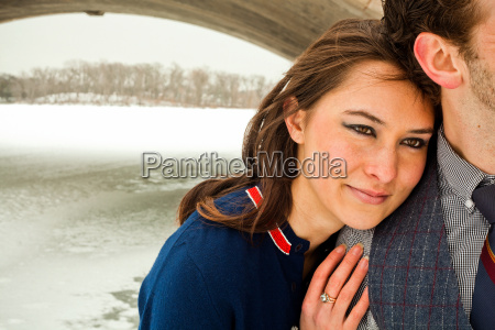 young couple embracing close up
