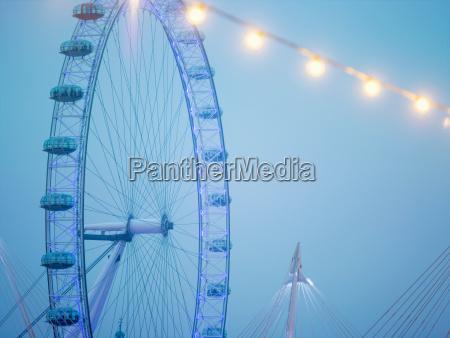 london eye ferris wheel in blue
