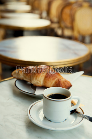 pastry and cup of coffee on