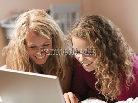 young woman and mother looking at