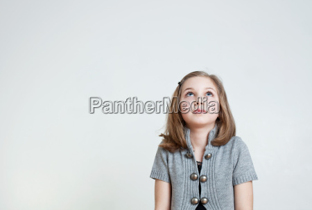 young girl looking up studio shot