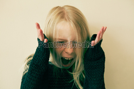 young girl screaming close up