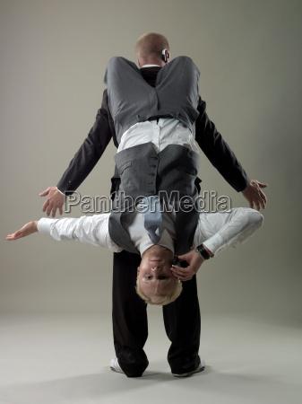 business men balancing
