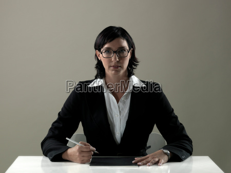 business woman by table