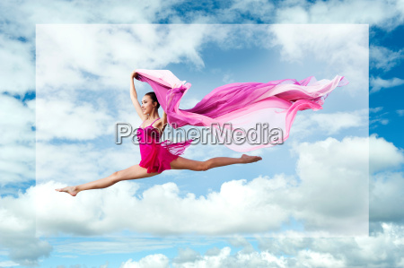 ballerina, leaping, against, cloudy, sky - 19542650