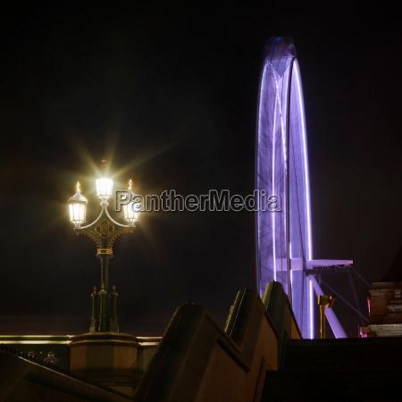 london eye spinning at night