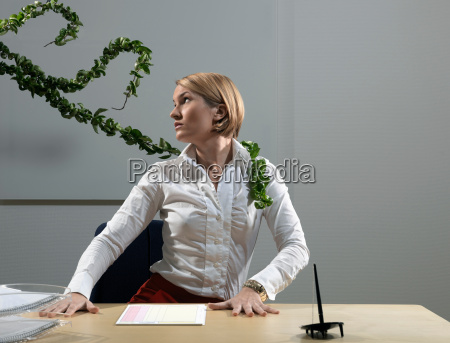 woman by desk beeing attacked by