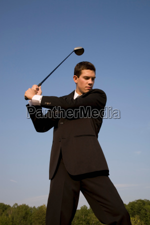 business man playing golf