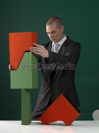 business man balancing paper holders