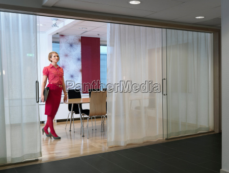 business woman standing in board room