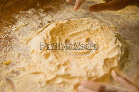 child baking with smiley face in