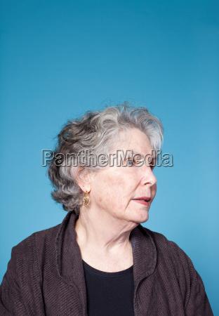 senior woman looking away studio shot