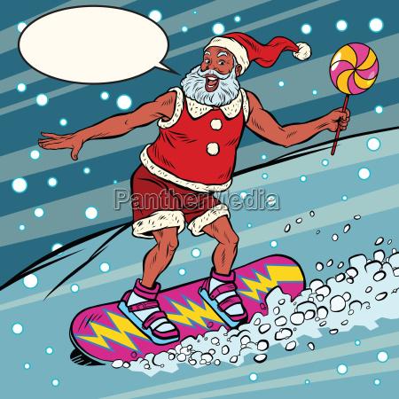 moderne weihnachtsmann reitet auf einem snowboard