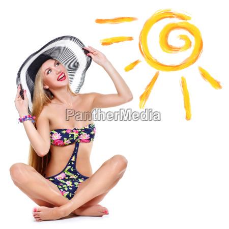 girl in bikini and summer hat