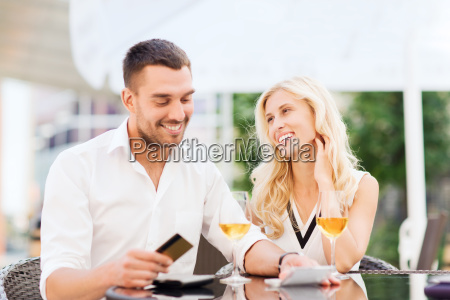 happy couple with bank card and