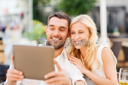 happy couple with tablet pc at
