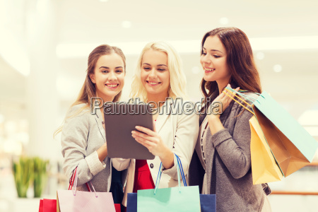happy young women with tablet pc