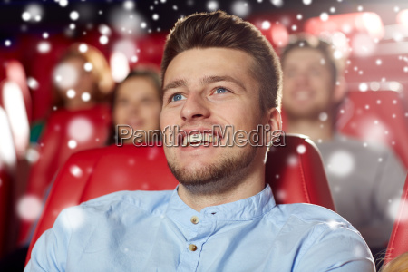 happy young man watching movie in