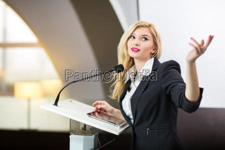pretty young business woman giving a