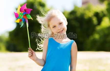 happy little girl with colorful pinwheel