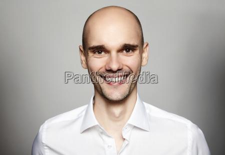smiling man in white shirt