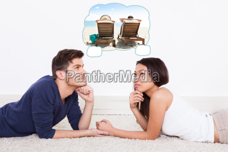 loving young couple lying on rug