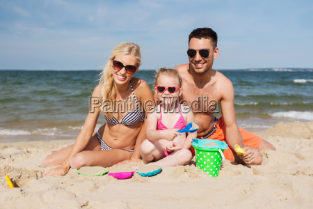 happy family playing with sand toys