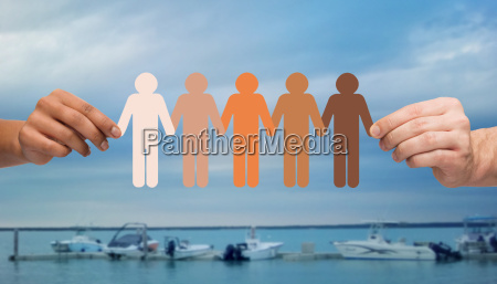 hands holding people pictogram over boats