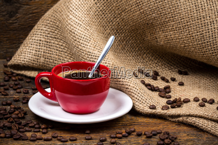 coffee cup with spoon coffeebeans and