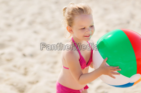 happy little girl playing inflatable ball