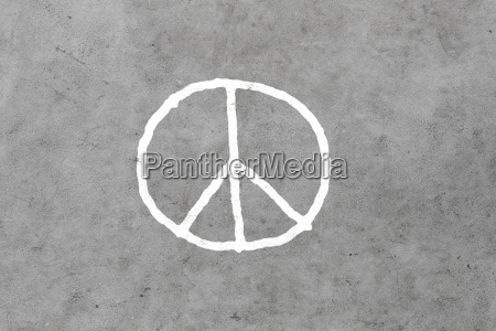 peace sign drawing on gray concrete