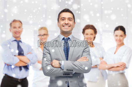 happy businessman over team at office