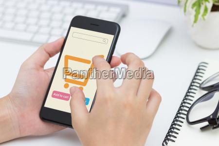 close up woman hand using phone
