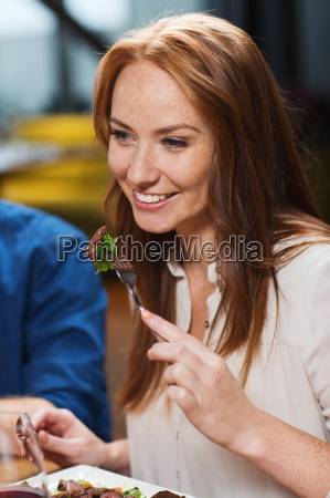 happy woman having dinner at restaurant
