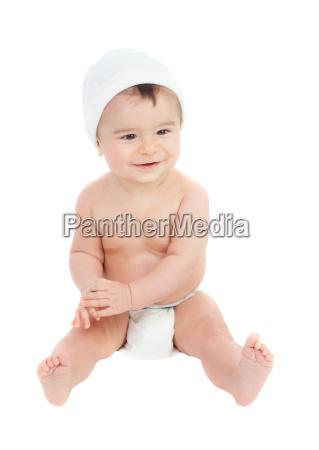 cute baby in diaper sitting