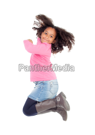 adorable african little girl jumping