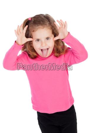 little girl in pink mocking